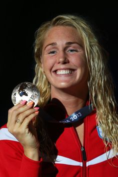 Gold medal winner Jeanette Otteesn Gray of Denmark celebrates on the podium after the Swimming Women's Butterfly 50m Final on day fifteen of the 15th FINA World Championships at Palau Sant Jordi on August 3, 2013 in Barcelona, Spain.