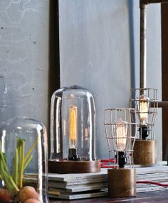 Industrial and traditional at the same time! Traditional rustic elm wood combined with industrial and modern edison bulbs and caged shades. These unique lamps would look great on your bookcase as an industrial accent light.