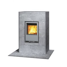 HIISI 3: Despite its compact size, the amazing new Hiisi fireplace builds up heat very effectively and meets emission norms that have not yet been enacted. The simple and graceful door is sunk stylishly flush with the soapstone surface.