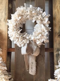Welcome your guests in warm and rustic style. Features hand torn cotton with tattered linen ribbon. Wreath measures approx 14 across with 48 of linen ribbon. Includes oatmeal colored cotton hand torn rags and natural beige linen hand torn ribbon. Tattered garland (pictured) also available for purchase, please see separate listing for details. Ribbon can be hand stamped with custom message, up to 12 characters. Convo for details.