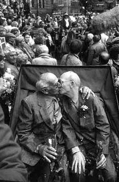 Alter Kocker kiss... Axel Axgil (3 April 1915 – 29 October 2011) and Eigil Axgil (24 April 1922 – 22 September 1995) were Danish gay activists and a longtime couple. They were the first gay couple to enter into a registered partnership anywhere in the world following Denmark's legalisation of same-sex partnership in 1989