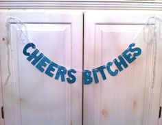 Our best-selling banner, CHEERS BITCHES, now in Teal! Perfect for your next girls night or bachelorette party.  By hawthorne ave arts & vintage on Etsy, $23.00