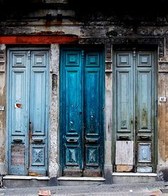 Love the bright middle and blue door. Would love those colors in a kitchen or a bathroom with bright accents of yellow orange or purple. With Moroccan tile.