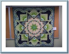 Judy quilts featured at the Quilting on the Kenai Quilt Show.  Most of these quilts were made by students of Certified Instructor Sue Wilson!  Glacier Star