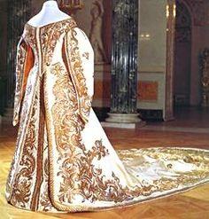 Court Gown of Empress Alexandra Feodorovna, Wife of Nicholas II  By Court Couturiére Mme. Olga Nicholaevna Bulbenkova (1835-1918),St. Petersburg, Circa 1890  White silk moiré silver and gold thread  Pavlovsk State Museum-Preserve  Inv. Nos. TsKh-2729-II, TsKh-2728-II, TsKh-2728-II