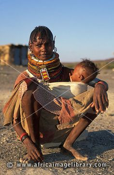 Photos and pictures of: Turkana woman with her baby, Loiyangalani on the shore of Lake Turkana, Kenya - The Africa Image Library All About Africa, Out Of Africa, East Africa, African Life, African Women, We Are The World, People Around The World, Beautiful World, Beautiful People
