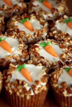 Carrot cupcakes with Cream Cheese Frosting (Whisk Kid). Nice with the nuts around the border.