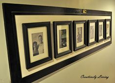 Old Pantry Door turned Hallway Picture Frame! Love this Idea!