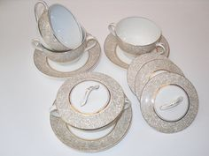 Four rare vintage lidded soup / desert bowls with saucers