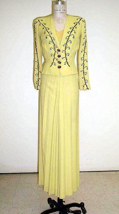 Ensemble, Evening  Elsa Schiaparelli (Italian, 1890–1973)  Department Store: for Bonwit Teller & Co. (American, founded 1907) Date: 1937–39 Culture: French Medium: rayon, silk, metallic thread, metal, plastic