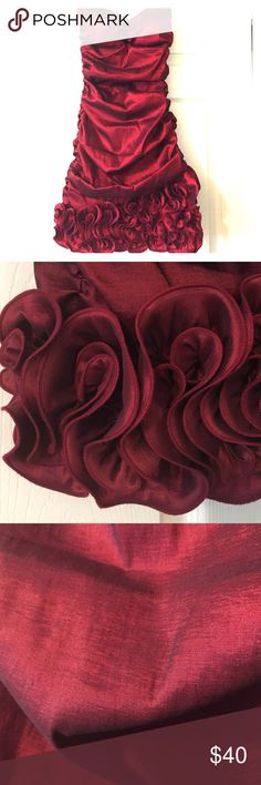 [Arden B] red rosette strapless dress Gorgeous on! Perfect for the holidays! Worn one time, in perfect condition. Material has a shiny sheen to it. Red/maroon color. Rouching on side. Beautiful rosettes on bottom. Lightly padded. Zipper in back. Size small, will fit 0-4, IMO. Poly, nylon and spandex blend- so a bit stretchy. Arden B Dresses Strapless