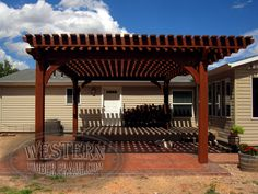 Free standing pergola with Rich Sequoia stain and Roosevelt profile. Upgraded extended rafters.