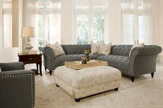 The Hutton tufted gray sectional and pillowtop ottoman go together like a glass of wine and a good book.