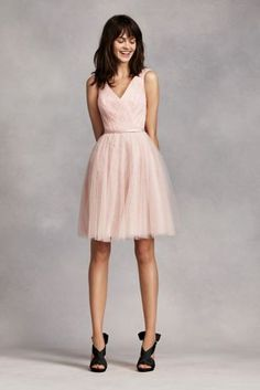 Short, flirty and sweet, you will look lovely in this beautiful dress!  Sleeveless tulle over lace dress with v-neckline and attached sash at waist.  A-line gathered skirt adds drama and dimension.  Fully lined. Back zip. Imported polyester. Dry clean only.