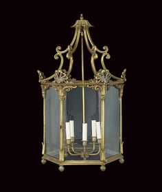 A GILT BRONZE HEXAGONAL HALL LANTERN  OF REGENCY STYLE, LATE 20TH CENTURY  With five light fitting to the interior . Christie's.