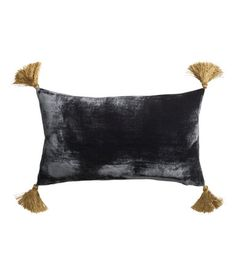More velvet! And tassels! Tassels are everywhere. Velvet Cushion Cover, $17.95, H&M US