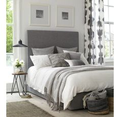 Create a calming atmosphere with a neutral palette. Grey is soft and pale, but unlike beige or cream it is natural like cool stone, making is one of the most calming neutral tones. Combine it with silver and mirrored finishes to create a multi-tonal space, in which the features needn't be matching but complementary, functional and beautiful.