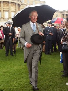 The Prince of Wales looked relaxed - and dry - as he toured the gardens during the sodden event
