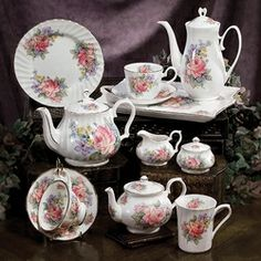 Made in England by Royal Patrician  Set Includes:  1- Bone China 6  Cup Teapot  1- Bone China 2-3 Cup Teapot  4- Bone China Cups & Saucers  4- Bone China 8