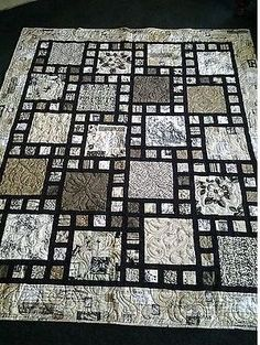 Black and White Quilt with Squares and Focus Fabric.