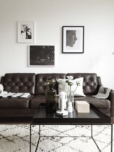 Chic industrial style: We love the darkbrown leather couch and this matching metal coffee table. Perfect combination of black and white details.