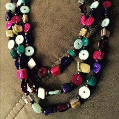 Colorful beaded necklace Colorful beaded necklace; three layers of beads. Pink/purple/teal/brown/etc Jewelry Necklaces