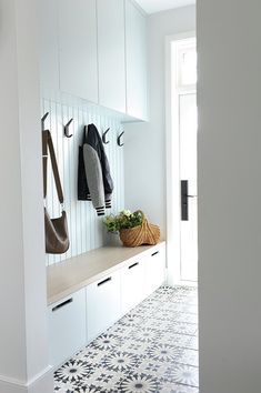 Adding black iron hooks on a white mudroom plank wa&; Adding black iron hooks on. Adding black iron hooks on a white mudroom plank wa&; Adding black iron hooks on a white mudroom pl Cupboard Storage, Room Design, House Interior, White Kitchen Design, Hallway Storage, Plank Walls, Interior, Kitchen Room, Mudroom Decor