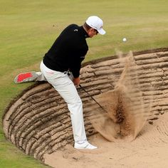 Despite having to escape this nasty pot bunker, Justin Rose (-10) shares the lead after firing a 66 at Royal Aberdeen.