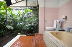 surf house bathroom.  Maybe not outside but enclosed with glass walls and such with live plants would be awesome