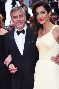Is Amal Alamuddin giving up the law to become a celebrity fashion designer? Amal Alamuddin's career as an International human rights lawyer has definitely...