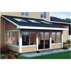 An enclosed porch with lots of windows....this would look so good on the back of our house