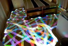 Long exposure of a roomba vacuum with color-changing light on top - Imgur