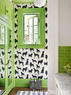 Fun paint color and a unique wallcovering were chosen to enliven this Atlanta mudroom. - Photo: Lisa Mowry / Design: Katie Rosenfeld