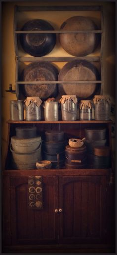 Old stoneware, old red dry sink, old wooden bowls, old firkins & pantry boxes.