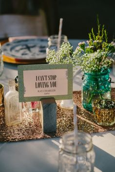 Tables Named After Their Favorite Love Songs | PhotoHouse Films | See More! http://heyweddinglady.com/ethereal-texas-garden-wedding-in-gray-pink-and-gold/