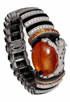 Panthère de Cartier High Jewelry bracelet Platinum, one 63.55-carat cabochon-cut spessartite garnet, garnets, onyx, obsidian, emerald, diamonds