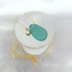 bab07c554a1 Gold pebble and aqua seaglass gold necklace with tiny aquamarine detail. .  . . #