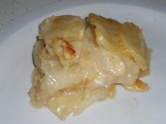 Scalloped Potatoes and Onions, the best scalloped potatoes you have ever eaten!  It is all in the secret ingredient. . . .