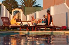 Hanging out by the pool in the sunset - Surf camp in Portugal