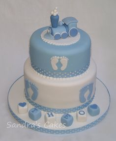 2 tier cornflower blue & white christening cake with train topper inspired by 'The Designer Cake Company'.