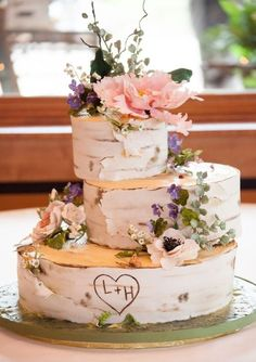 rustic wedding cake looks like tree bark with carved initials