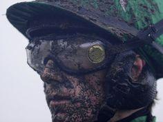 Sam Twiston-Davies shows just how much mud was flying at Cheltenham's New Year meeting.