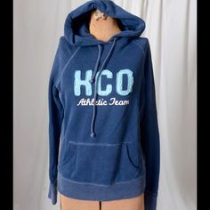 Blue Hollister hoodie Blue over the head Hollister hoodie.  Hoodie has pockets in the front.  Felt letters on the front and cuffs and bottom of hoodie have wear. Hollister Tops Sweatshirts & Hoodies