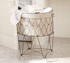 French Wire Hamper: http://www.stylemepretty.com/living/2015/03/25/the-prettiest-laundry-room-weve-ever-laid-eyes-on-must-have-storage/
