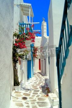 Picturesque whitewashed street in the old town of Mykonos Greece