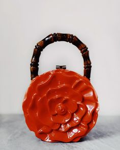 Hand-carved rose clutch with candy coating lacquer finish, and signature lock Lacquer finishAcacia WoodGold/Silver lockSuede lining Human Trafficking, Leather Backpack, Hand Carved, Artisan, Carving, Silver, Bags, Collections, Craftsman