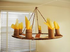 Made out of cardboard, toilet paper rolls, yellow tissue paper, brown construction paper, hot glue, and brown string.