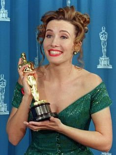 """1993: Actress Emma Thompson reacts as she poses with her Oscar at the 65th annual Academy Awards after winning the Best Actress category for her role in """"Howards End."""" Photo: Getty Images"""