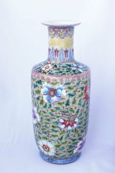 Fine Chinese Ovoid Porcelain Vase, with a spreading lip, above cylindrical neck, enamelled with trailing flower heads in bright tones of orange, blue, pink and green on a yellow ground, evidence of minute crazing to surface, on circular foot, with six character Kangxi in double circle to base, h 25.5cm