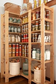 Don't waste your kitchen closet on buckets and a broom. Six-foot-tall pine shelving units transform this space into a pantry that maximizes corners. Fill the shelves with preserves, dry goods and more! See more of this country kitchen.